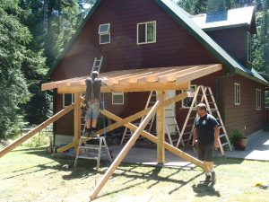 Oyster bay rear porch roof under construction by Heikess Homes Contracting